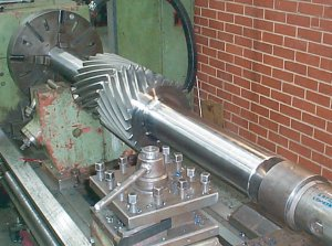 Double helical gear being cut in a lathe