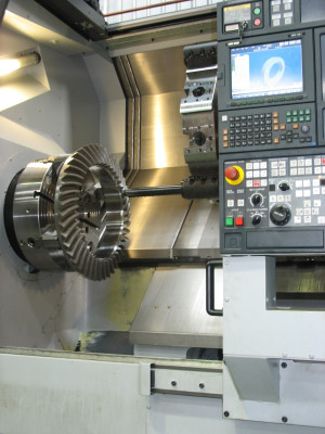 CNC gear cutting a spiral bevel gear